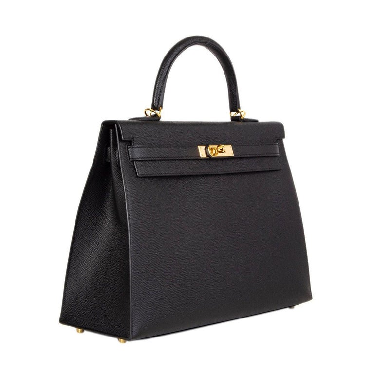 Hermes 'Kelly II 35 Sellier' in black Veau Epsom leather with gold-plated hardware. Removable shoulder strap. Closes with a turn-lock and straps on the front. Lined in Chevre (goat skin) with two open pockets against the front and a zipper pocket