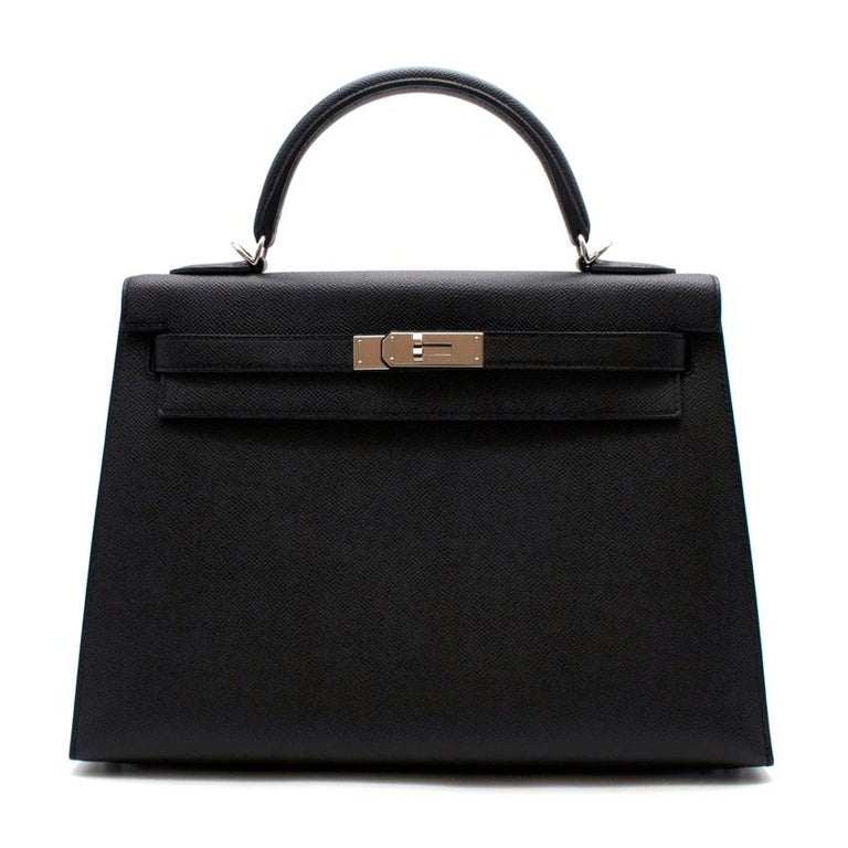 Hermes Black Epsom Leather Kelly Sellier 32 PHW  One of the most desirable and celebrated bag designs in the world the Hermes Kelly was designed in the 1930's. Renamed after Princess Grace of Monaco, it's timeless elegance and minimal style earned