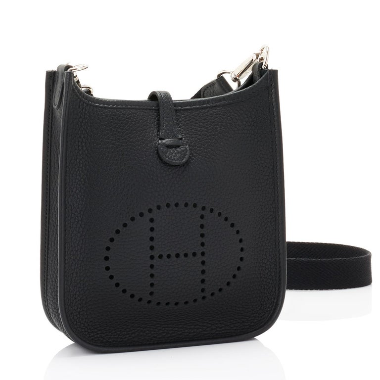 Hermes Black Evelyne TPM Shoulder Cross Body Bag Brand New in Box. Store Fresh. Pristine Condition. Perfect gift! Coming in full set with shoulder strap, Hermes sleepers, and Hermes box.  Very rare and ultra chic! This Black Evelyne Tres Petite