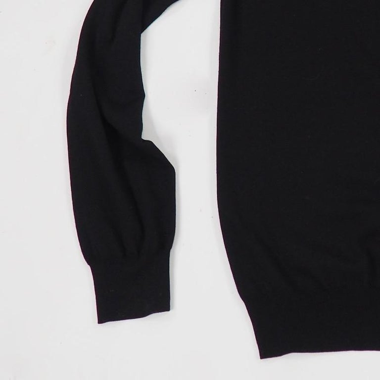 A beautiful black fine Hermes wool sweater with a subtly ribbed neck and cuffs. Great for all seasons.