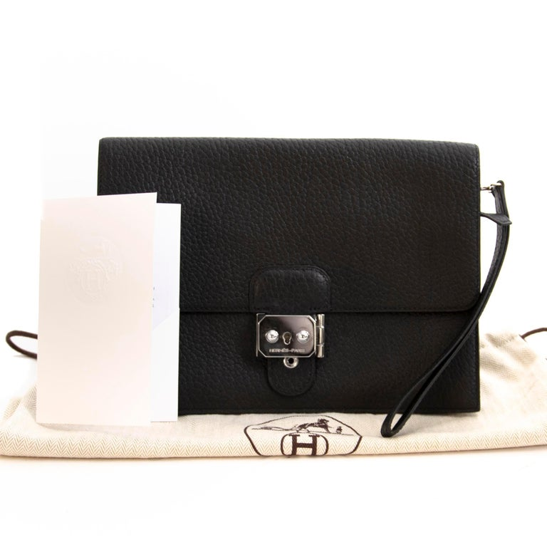 Very Good Condition  Hermes Black Fjord Pochette Jet  We adore this extremely rare and practical unisex