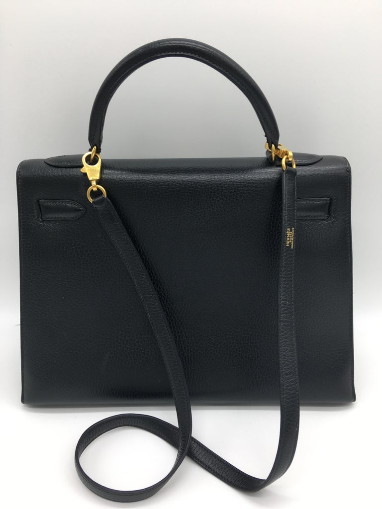 Probably one of the most glamorous and famous Hermes bags – a Black Kelly with Gold Hardware in the structured Sellier design with external stitching which gives it a particularly distinctive look. This is a 32cm Black Kelly Sellier in Evergrain