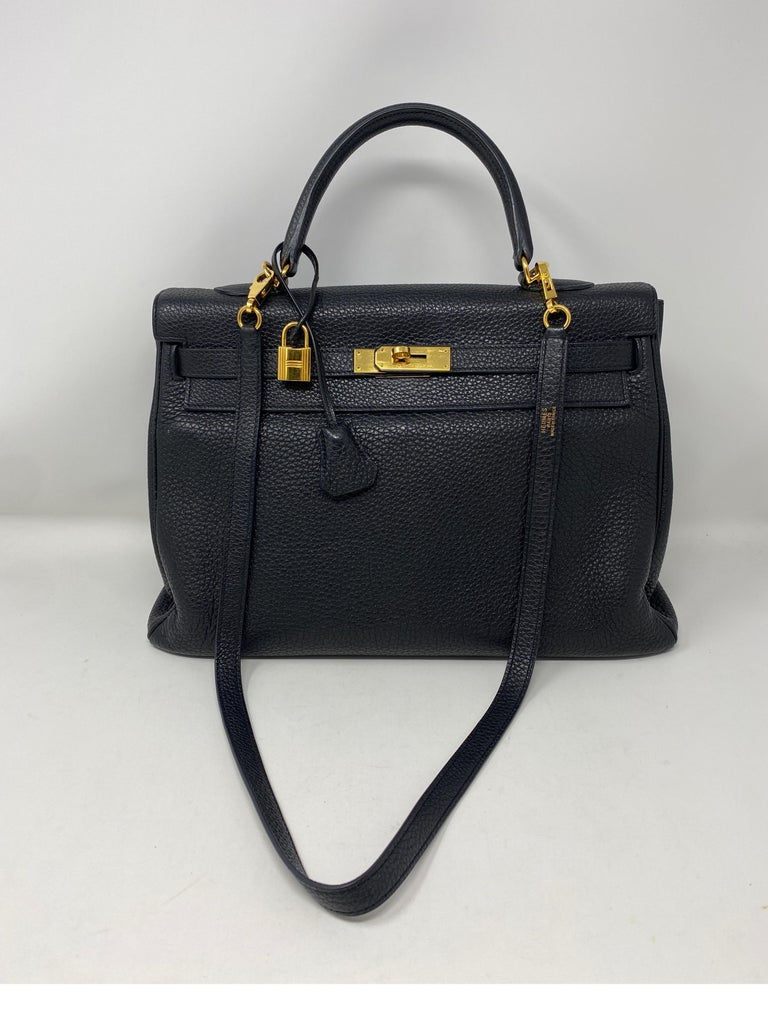 Hermes Black Kelly 35 Togo Leather Bag. Classic combination. Black with gold hardware. Good condition. Includes clochette, lock, keys, and dust cover. Guaranteed authentic.