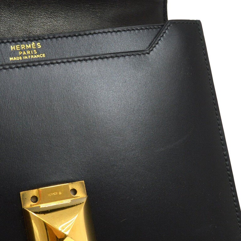 A Versatile, Understated Hermes Bag at its Finest.  Combining rich box leather and shiny gold accents, this classic Hermes shoulder bag is a rare find in beautiful condition. Featuring statement turnlock hardware and an adjustable shoulder, say