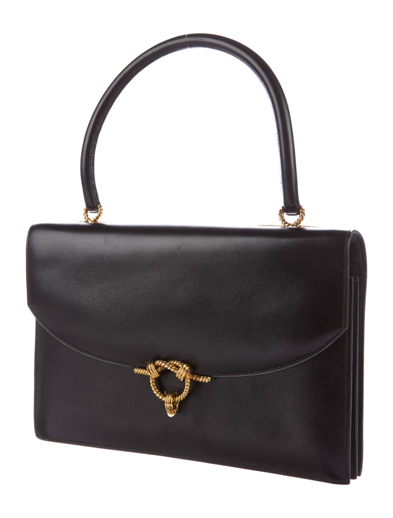 CURATOR'S NOTES  Hermes Black Leather Gold Rope Kelly Style Evening Top Handle Satchel Flap Bag  Leather Gold tone hardware Leather lining Flip lock closures Blind stamped Made in France Handle strap drop 5