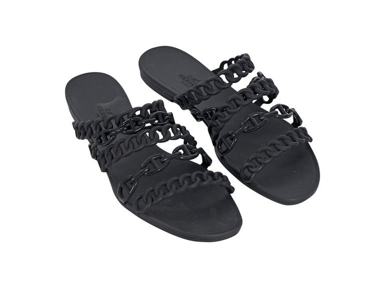 Product details:  Black rubber Chaine d'Ancre sandals by Hermes.  Faux chain straps.  Open toe.  Slide-on style.  Condition: Pre-owned. Very good. Est. Retail $ 950.00