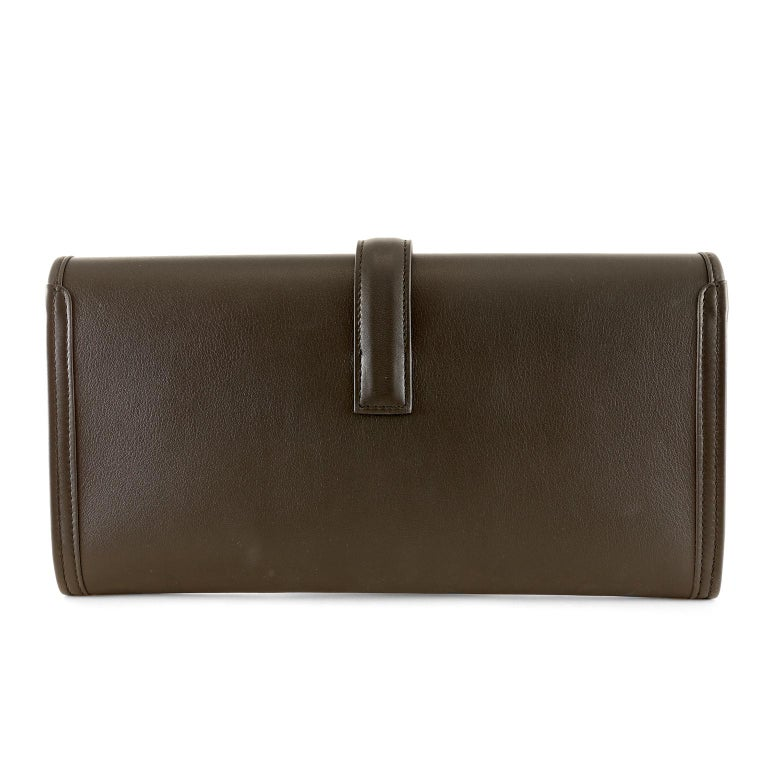 Hermès Black Swift Calfskin Jige Elan 29- New; never carried The penultimate clutch for any occasion, it is a must have for any sophisticated wardrobe.   Black smooth Swift calfskin slim clutch has an H belted closure.  Black leather interior.  C