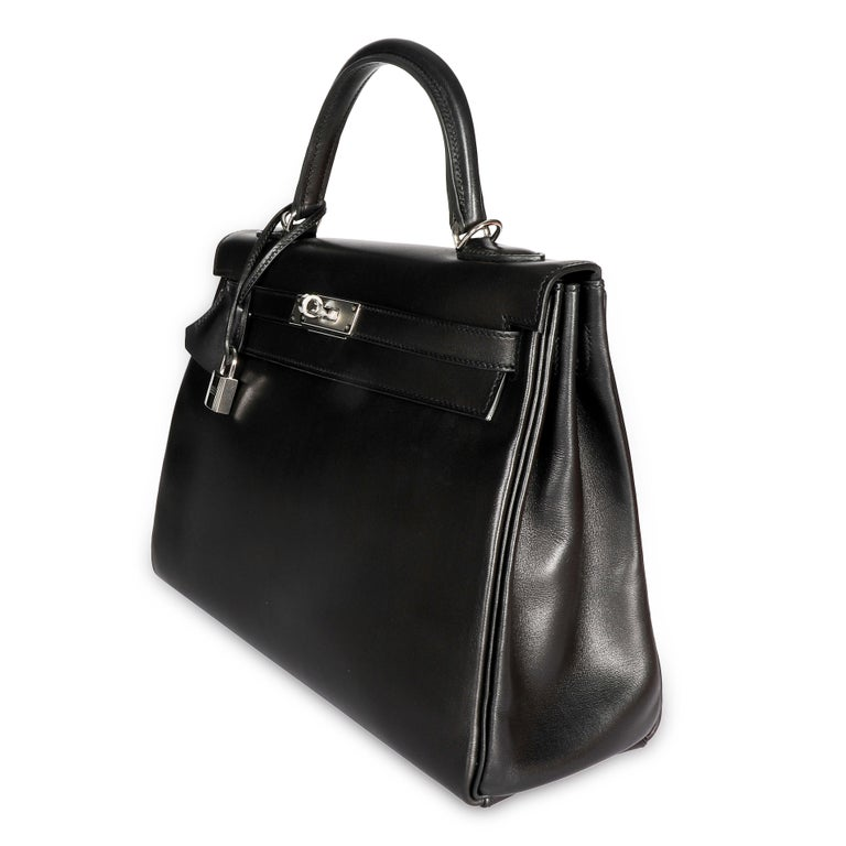 Listing Title: Hermès Black Swift Leather Retourne Kelly 28 with Palladium Hardware SKU: 108273  Condition Description: First conceived in 1930, by Robert Dumas, as a classic and elegant bag for the modern and independent woman. It had been referred