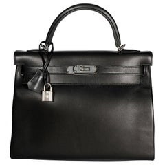 Hermès Black Swift Leather Retourne Kelly 28 with Palladium Hardware