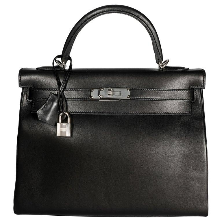 Hermès Black Swift Leather Retourne Kelly 28 with Palladium Hardware For Sale