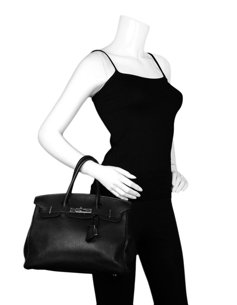 Hermes Black Togo Leather 30cm Birkin Bag W/ PHW  Made In: France Year of Production: 2005 Color: Black, silver Hardware: Palladium  Materials: Togo leather Lining: Black leather Closure/Opening: Flap top with two leather arms that come to center