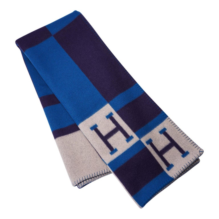 Guaranteed authentic Hermes Avalon Bayadere blanket featured in Blue Marine. Created from 90% Merino Wool and 10% cashmere and has whip stitch edges. Fabulous with the peacock blue  and ecru to compliment any room! New or Pristine Store Fresh