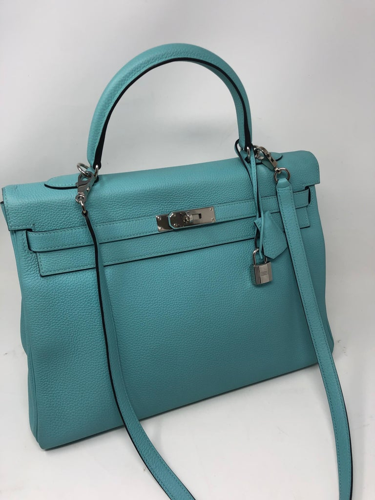 Hermes Bleu Atoll Kelly 35 Bag. Like brand new condition. Palladium hardware. Veau Togo leather. Kelly bag with strap. Beautiful light aqua color. From 2015 practically brand new. Includes lock, keys, clochette, and dust cover. Guaranteed authentic.