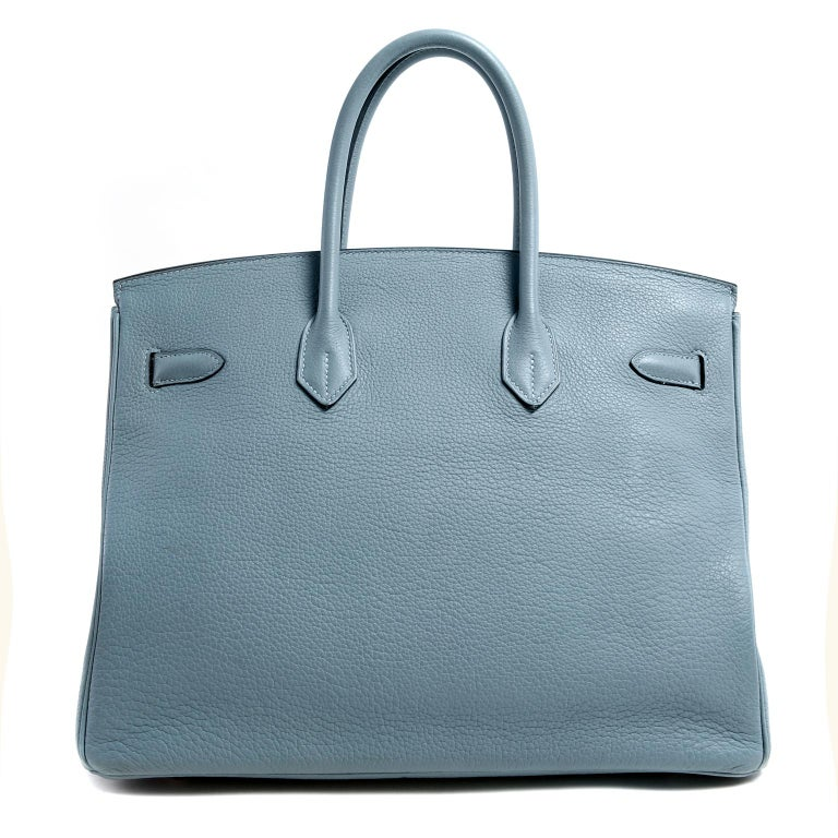 This authentic Hermès Bleu Ciel Clemence 35 cm Birkin is in excellent condition. Hermès bags are considered the ultimate luxury item the world over.  Hand stitched by skilled craftsmen, wait lists of a year or more are common.  Bleu Ciel is a soft