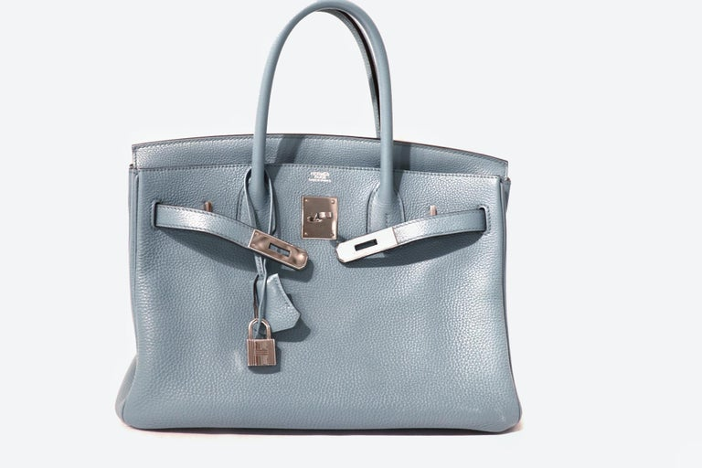 This authentic Hermès Bleu Ciel Togo 30 cm Birkin is in excellent condition.    Hand stitched by skilled craftsmen, wait lists of a year or more are common for the Hermès Birkin. They are considered the ultimate in luxury fashion. Bleu Ciel, a pale