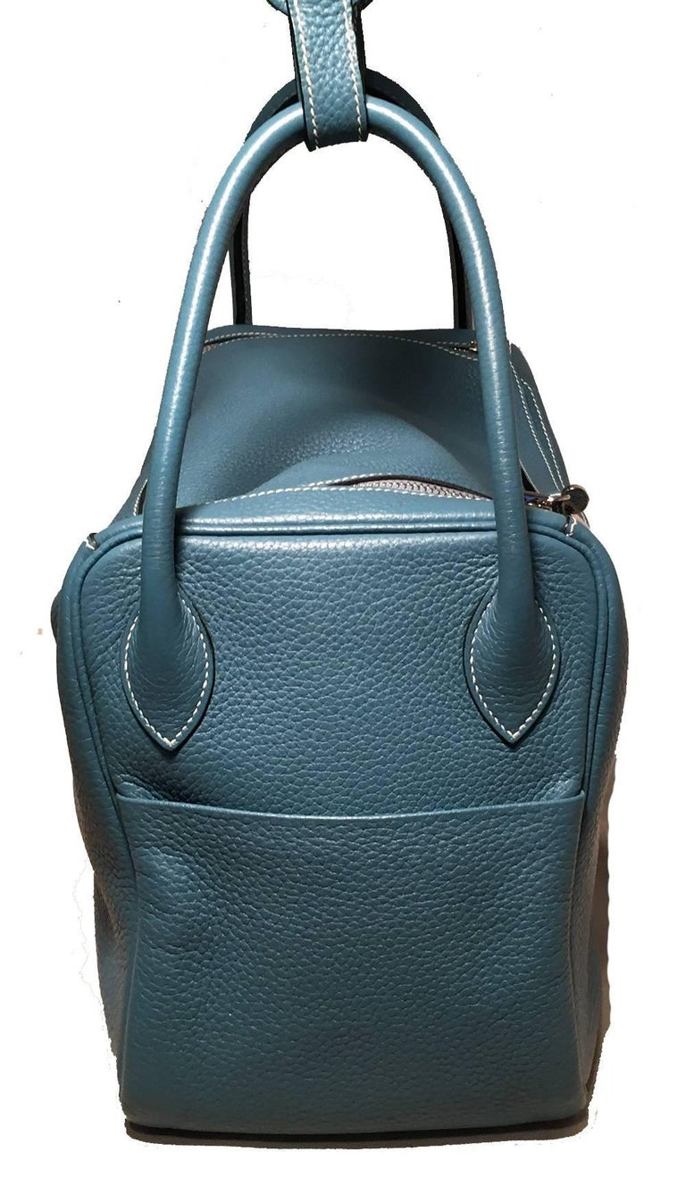 Absolutely Stunning Authentic Hermes blue jean lindy bag in excellent condition.   clemence leather exterior trimmed with shining palladium hardware. Two side slit exterior pockets for added storage. Double handles to carry or attached shoulder