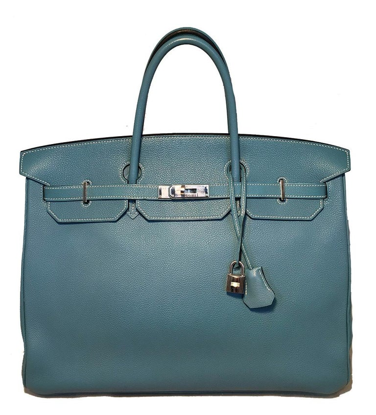 Hermes Blue Jean Togo Leather 40cm Birkin Bag in excellent condition. Blue jean togo leather exterior trimmed with silver palladium hardware. Front signature double strap twist front closure opens to a matching blue kidskin lined interior that holds