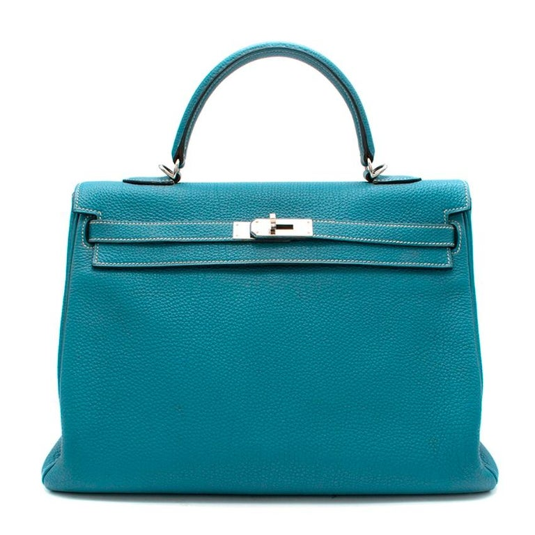 Hermes Blue Jean Togo Leather Kelly 35 PHW  - Serial Number [N] 2010 - Palladium Plated Hardware - Signature palladium plated hardware  - Signature twist-lock fastening - Removable shoulder strap - Interior zip pocket - Two interior slip