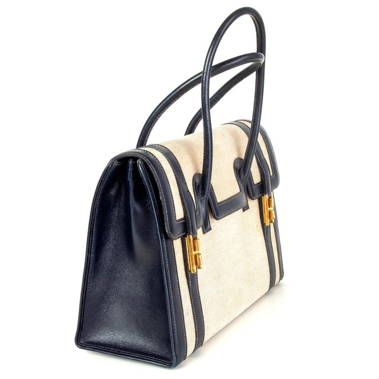 Hermès 'Drag 30' handbag in Bleu Marin (navy blue) Veau Box leathe and Toile. Lined in Chevre (goat skin) with two open pockets against the front and a zipper pocket against the back. Has been carried with some stains on the canvas and shows some