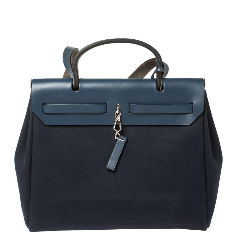 Made from canvas and leather, the Herbag Zip is just as outstanding as all of Hermes' other handbags. First introduced in 2009 as a new version of the Herbag, this piece comes with a single handle, a long shoulder strap and it flaunts fabulous