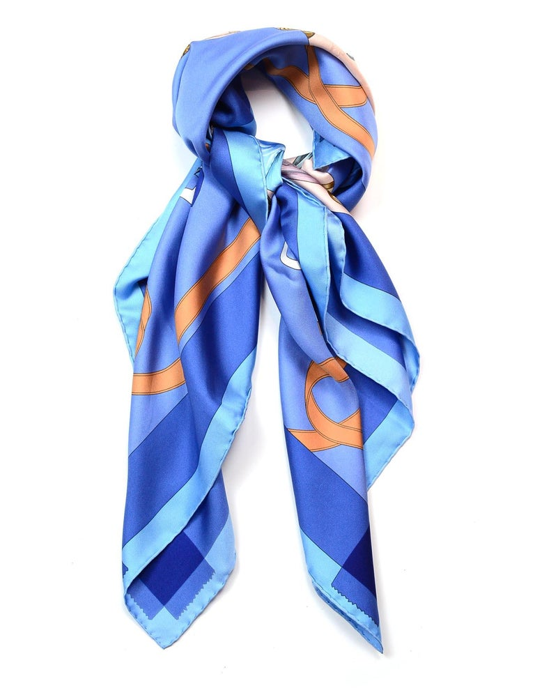 Hermes Blue/Orange Tout En Carre 90CM Silk Scarf  Made In:  France Color: Blue, orange Materials: 100% silk Overall Condition: Excellent pre-owned condition with exception of pull along the light blue border of the scarf Estimated Retail: $395 +