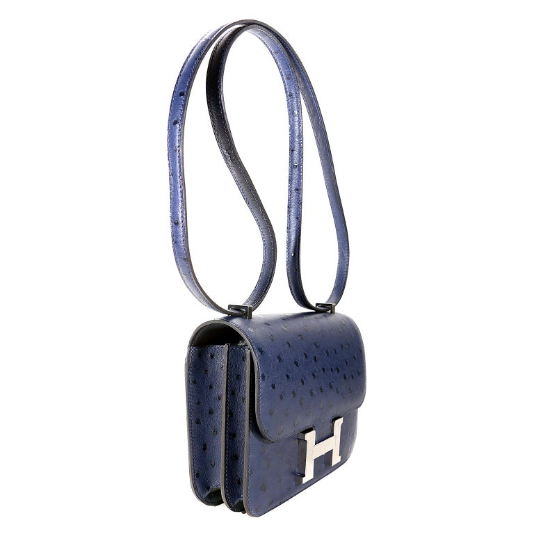 Hermès Blue Roi Ostrich Constance Mini 18 -PRISTINE  Unworn Condition One of Jackie O's favorite Hermès styles, she was often photographed wearing one of the many in her collection. This exotic ostrich version is extremely rare; a special piece for