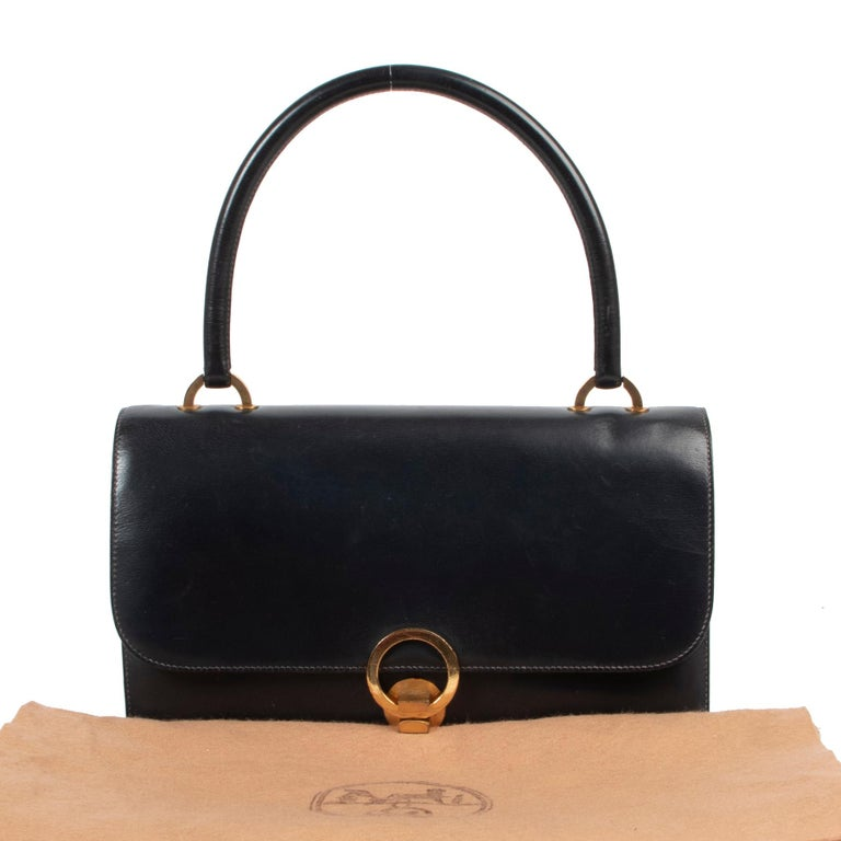 Hermès Blue Shoulder Bag  Complete your party outfit with this gorgeous Hermès bag.All your party essentials will fit in this bag. The interior features two comparments and several small pockets.The bag is finished with gold toned hardware and is