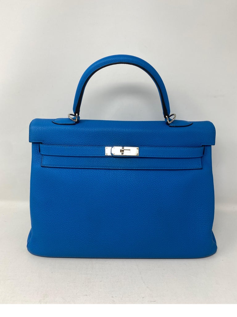 Hermes Blue Zanzibar Kelly 35 Bag. Palladium hardware. Excellent like new condition. Vibrant blue color. Togo leather. Kelly bags are classic investments. Includes clochette, lock, keys, and dust cover. Guaranteed authentic.