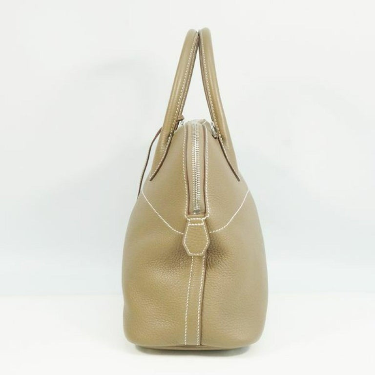 An authentic HERMES Boledo31 Womens handbag Etooope x silver hardware. The color is Etooope x silver hardware. The outside material is Taurillon Clemence. The pattern is Boledo31. This item is Contemporary. The year of manufacture would be