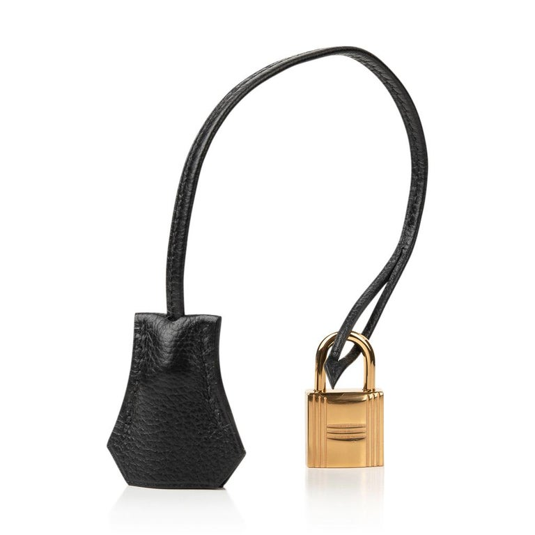 Guaranteed authentic Hermes Bolide 30 1923 is sleek, clean and modern and easy to fall in love with. Black with Gold hardware sets this beauty apart. Taurillon Novillo leather has stepped to the forefront for good reason. Bull leather, with a grain