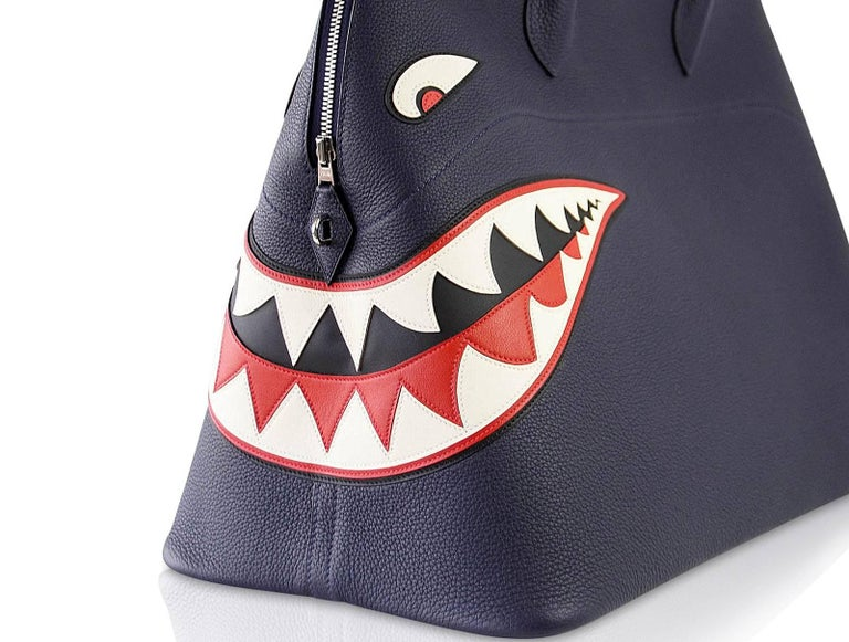 Guaranteed authentic rare and very limited edition Blue Indigo Shark Bolide is detailed by beautiful inset leather and  top stitch detailing. This runway Monster Bolide is a testament to Hermes sense of mobility and speed expressed in this fun,