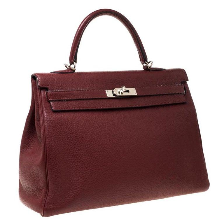 Hermes Bordeaux Togo Leather Palladium Hardware Kelly Retourne 35 Bag In Fair Condition For Sale In Dubai, Al Qouz 2