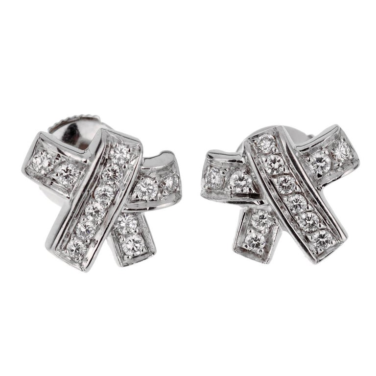 A chic set of Hermes stud earrings featuring a bow motif adorned with the finest Hermes round brilliant cut diamonds in 18k white gold.