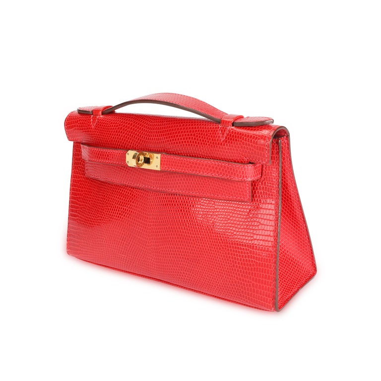 Listing Title: Hermès Braise Niloticus Lizard Kelly Pochette GHW SKU: 108897 MSRP:   Condition: Pre-owned (3000) Condition Description:  Handbag Condition: Very Good Condition Comments: Very Good Condition. Scratching and tarnishing to hardware.