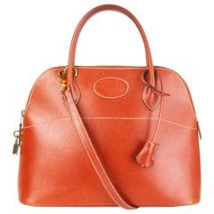 HERMES Brique red orange Box leather BOLIDE 31 Bag