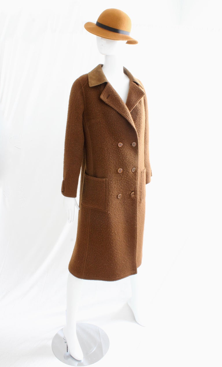 This fabulous coat was made by Hermes Paris, most likely in the late 1970s.  Made from brown boiled wool blend, it features a brown suede collar and is unlined.  In excellent condition with minimal signs of prior wear.  Tagged HERMES MADE IN FRANCE