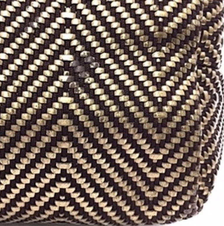 Canvas Leather Gold tone hardware Woven lining Made in France Measures 9.5