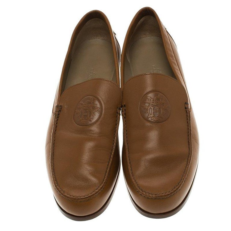bcb5bfa61e9 Hermes is known for their sophisticatedly created designs. These brown  Lucky moccasins have been crafted