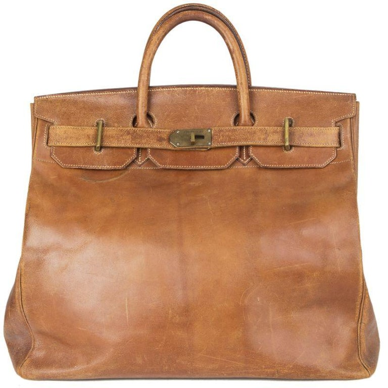 Hermes 'Haut a Courroies 45' bag in medium brown Veau Box leather. Rare vintage 1940s model with brass hardware. Unlined. Has been carried and shows an overall patina and signs of use. Please look at the pictures carefully to see condition. Overall