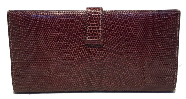 AMAZING Hermes Brown Lizard H Wallet in excellent condition.  Brown lizard leather exterior trimmed with gold hardware.  Sliding strap closure opens to a brown kidskin lined interior that holds 5 card slit pockets, 3 larger slit pockets and a