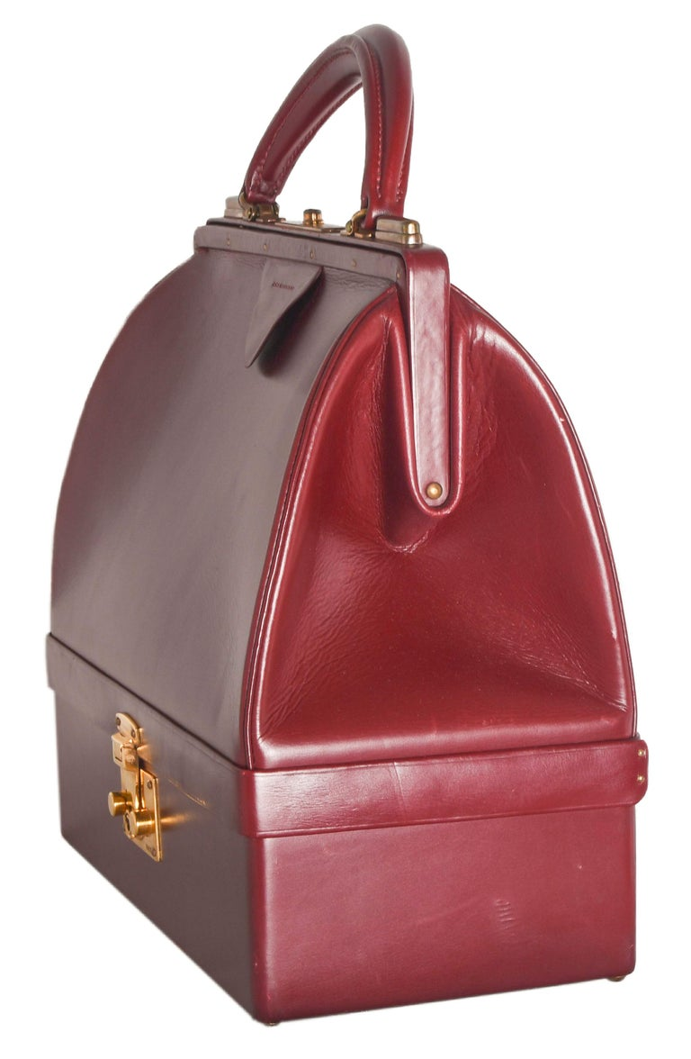 Hermes Vintage Sac Mallette was originally designed as a travel case during the Roaring '20s.  Now it doubles as a sophisticated handbag with purpose.  Quite rare, this exceptionally stunning piece is a must have for collectors. Glossy rouge box