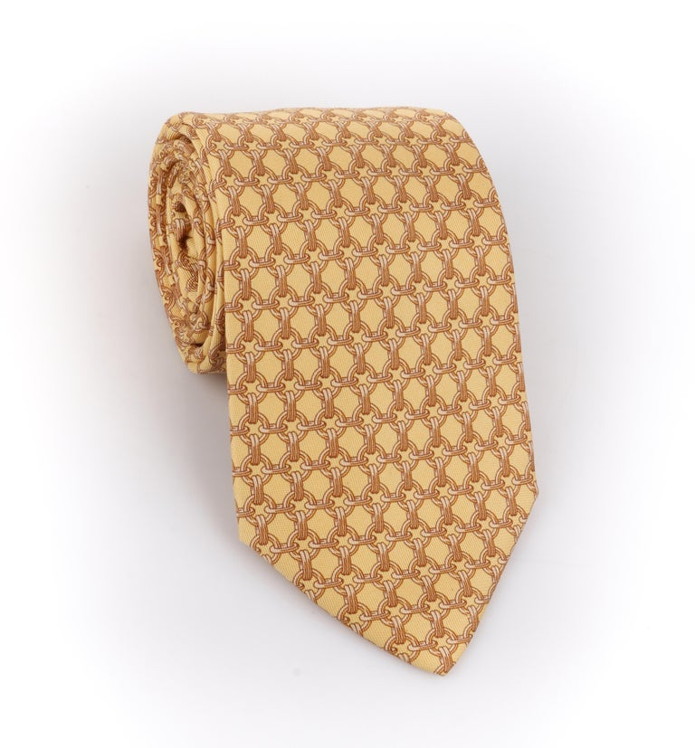 DESCRIPTION: HERMES Butter Yellow Chain Link Print 5 Fold Silk Necktie Tie 59 EA   Brand / Manufacturer: Hermes Style: 5 fold necktie Color(s): Shades of yellow and gold Lined: Yes Marked Fabric Content: 100% Silk Additional Details / Inclusions: