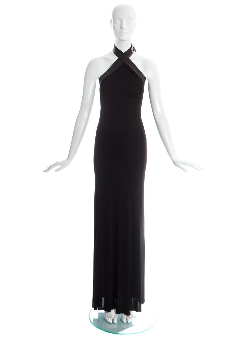 Hermes by Jean Paul Gaultier; black silk jersey evening maxi dress with black lambskin leather halter neck strap with 'Collier de chien' silver closure and padlock.   Fall-Winter 2009