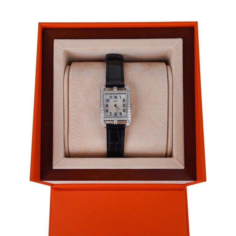 Guaranteed authentic Hermes Diamond Cape Cod watch. The watch has 50 brilliant bead set diamonds for a total carat weight of 1.25. The 23 mm x 23 mm watch has an opaline silvered dial. Shiny black Alligator skin strap. Quartz movement made in