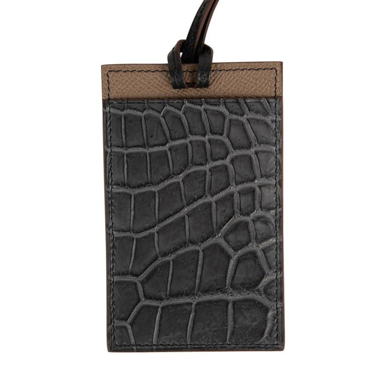 Guaranteed authentic Hermes Petite h Lanyard card holder. Graphite Matte Porosus Crocodile and Etoupe in Epsom leather. Card holder has a slot on each side and a thin Black Epsom leather strap. Comes with box and Cites. New or Never Worn. final