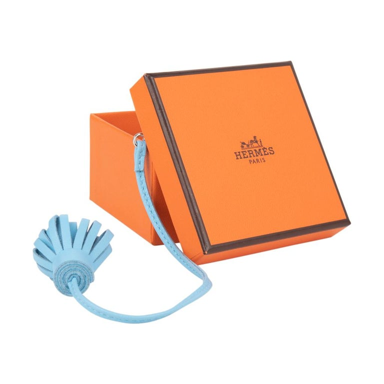 Guaranteed authentic coveted Hermes page marker bookmark features Blue Celeste Milo lambskin. A charming companion for the Vision agenda or Ulysse PM notebook.  Comes with Hermes box.  New or Store Fresh Condition final sale  SIZE: MEDIUM LENGTH