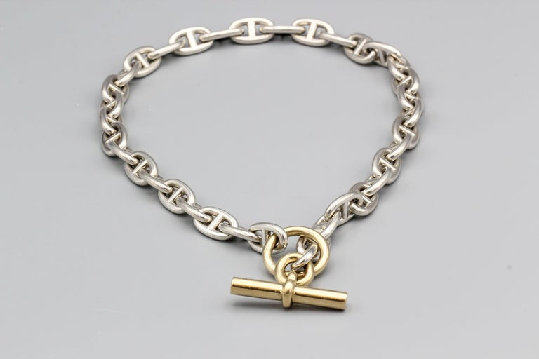 Stylish 18K gold and sterling silver toggle link necklace , from the Chaine D'Ancre collection by Hermes.  It is the large size and features an 18k gold toggle with sterling silver links.  Hallmarks: Hermes, French 18k gold assay mark, maker's mark.