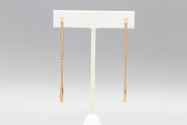 Fine diamond and 18K rose gold drop earrings from the