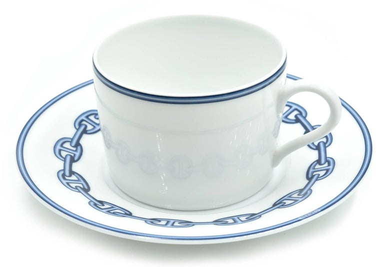 Designer: Hermes Collection: Chaine D'Ancre Material: porcelain Set: two cups and two plates included Dimensions of Cups: 3 inches in diameter and 2 inches tall Dimensions of Plates: 5 ¾ inches in diameter and 1 inch tall