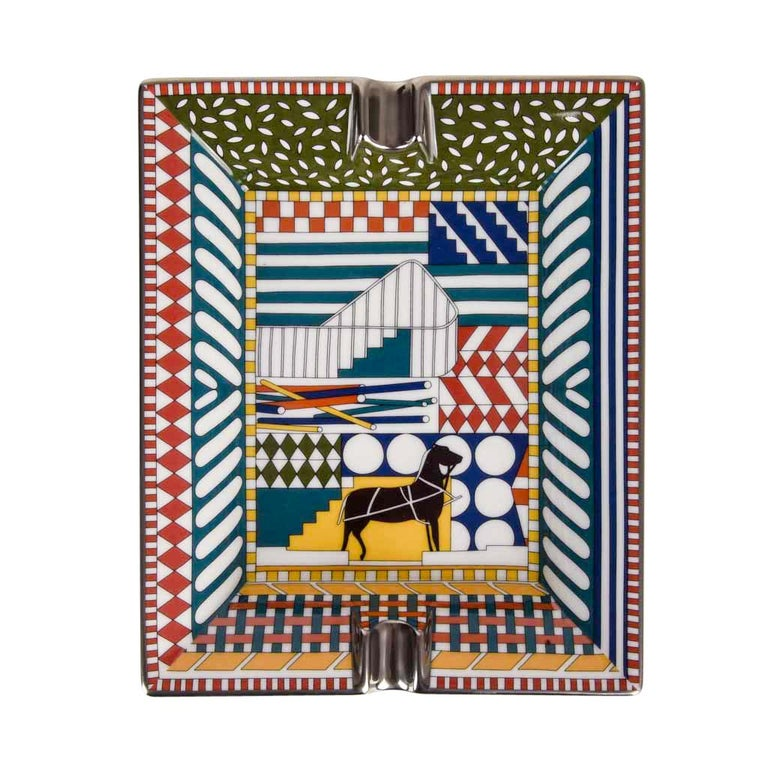 Guaranteed authentic Hermes marvelous Au Faubourg change tray. Printed Limoges Porcelain with signature Horse accent. Rich colour and print combination creates a perfect accent piece for any room. Protected by velvet goatskin on the base. Wonderful